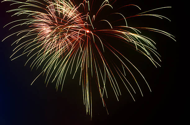 fireworks of various colors over night sky stock photo