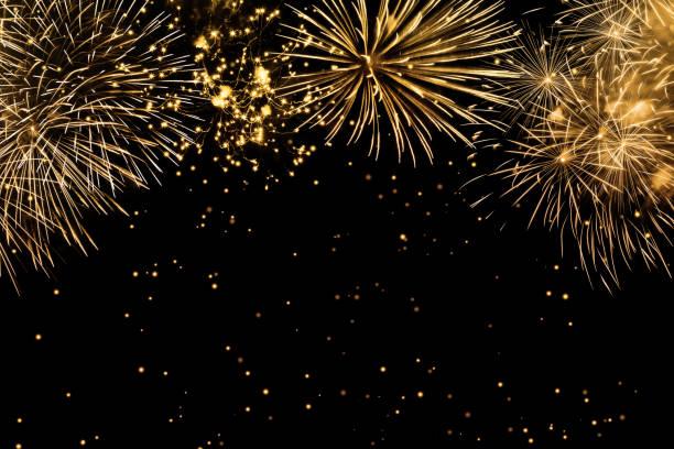 fuegos artificiales sobre fondo negro - año nuevo fotografías e imágenes de stock