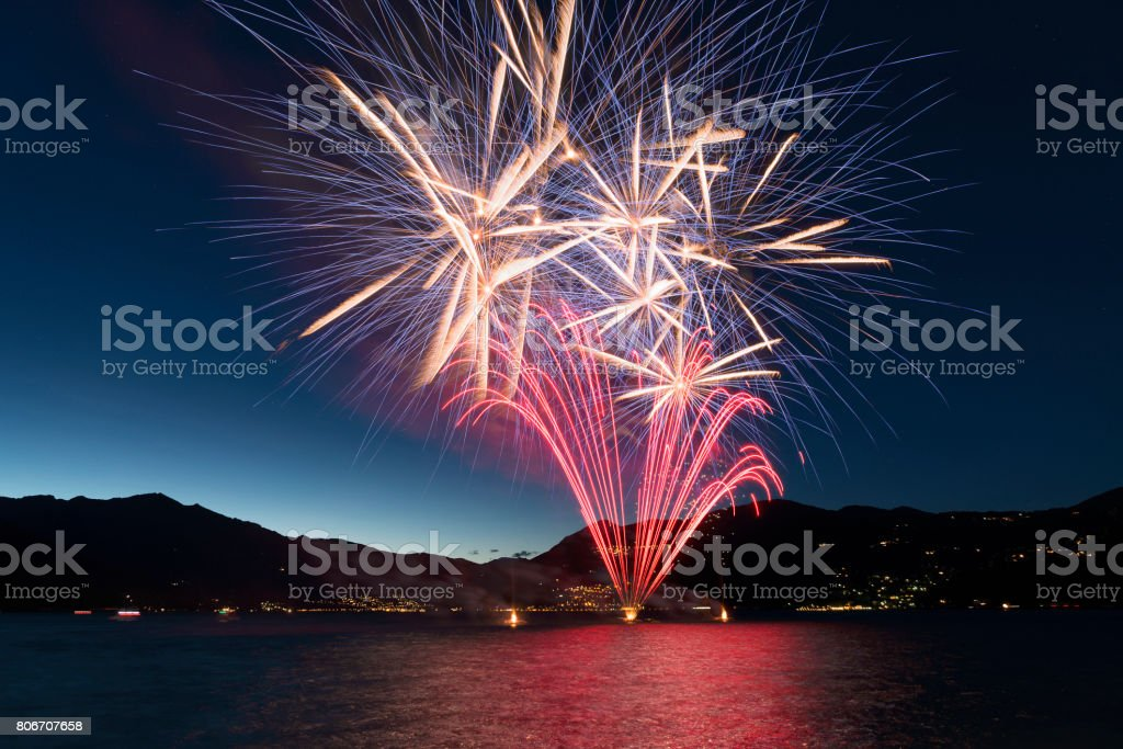 Fireworks on the lake in a summer evening stock photo