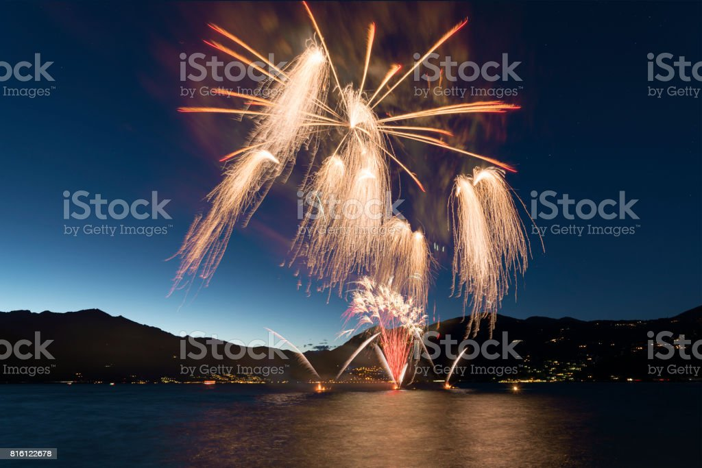 Fireworks on the lake in summer night stock photo