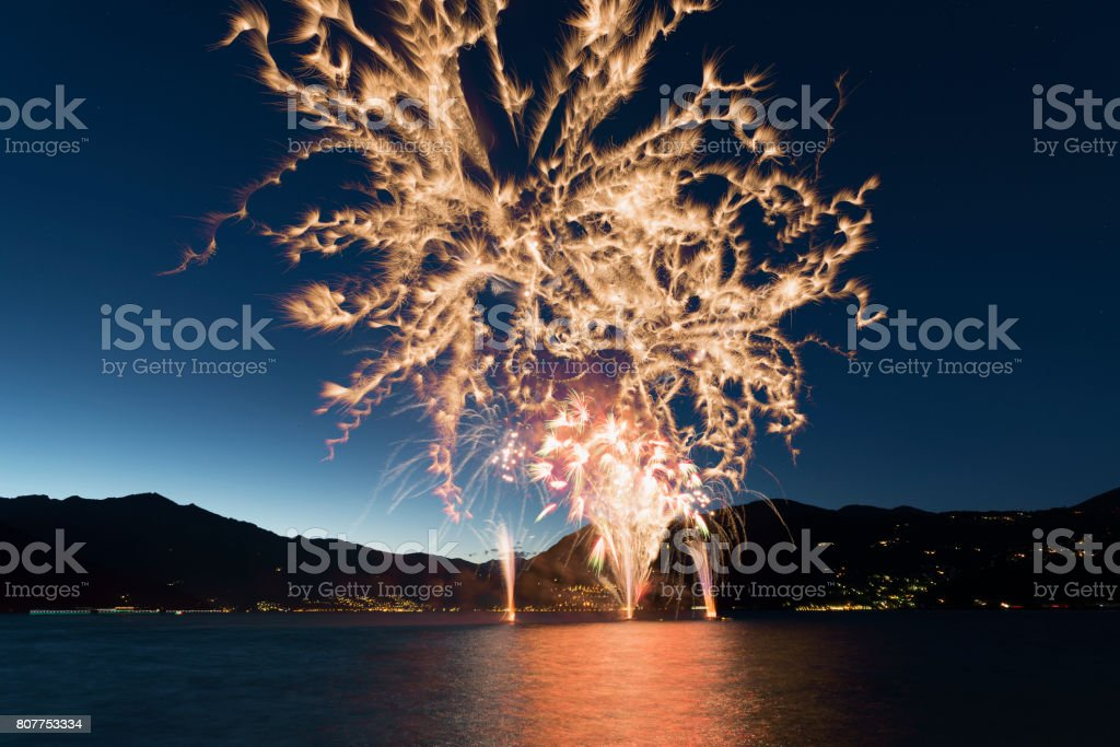 Fireworks on the Lake Maggiore in a summer evening stock photo