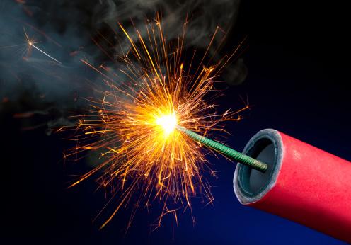 Fireworks or Explosives With Sparkling Lit Fuse