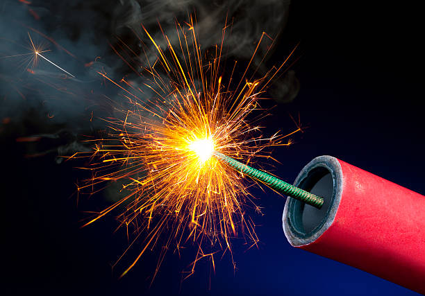 Fireworks or Explosives With Sparkling Lit Fuse stock photo