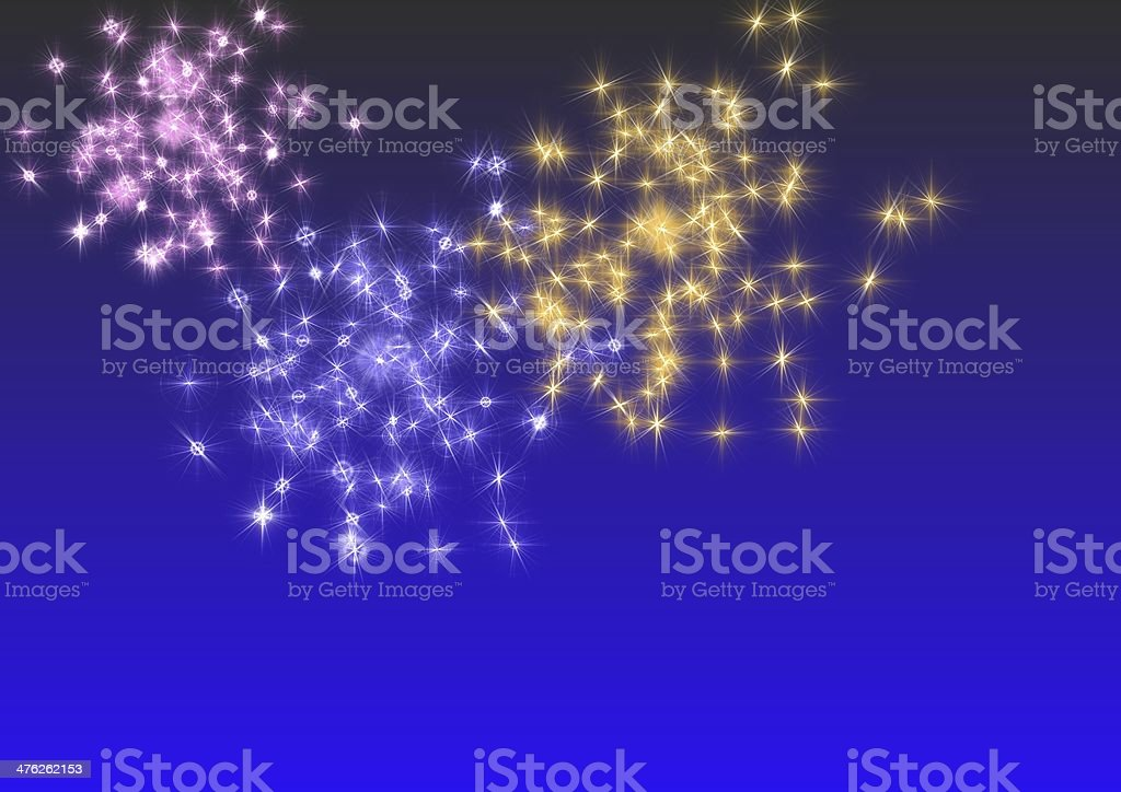 fireworks over a blue sky royalty-free stock photo