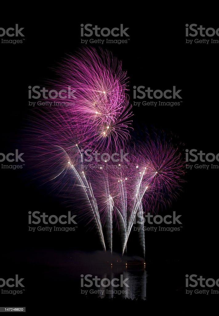 Fireworks over a lake royalty-free stock photo