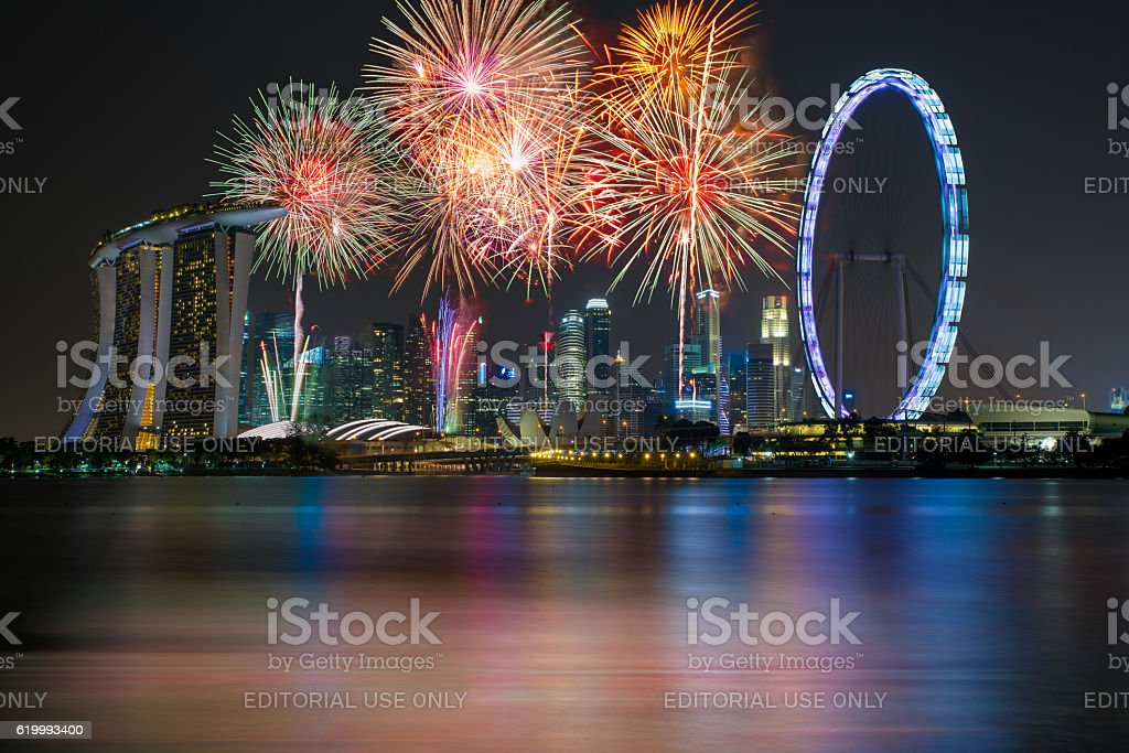 Fireworks over Marina bay in Singapore on New years fireworks. stock photo