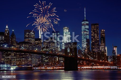 952065128 istock photo Fireworks over New York City skyline and Brooklyn Bridge 952065110