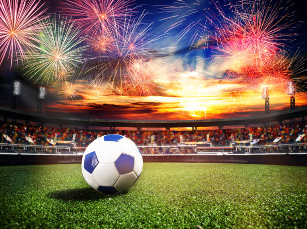 Fireworks over soccer stadium as final win game stock photo