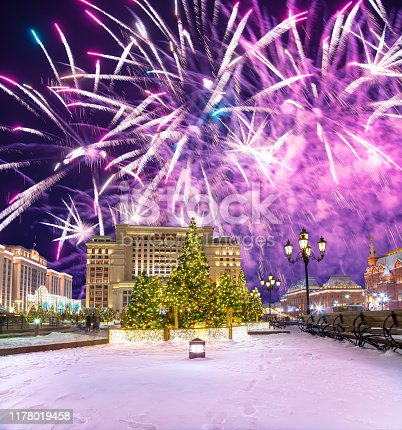 Fireworks over the Christmas and New Year holidays illumination and Manege Square at night. Moscow, Russia