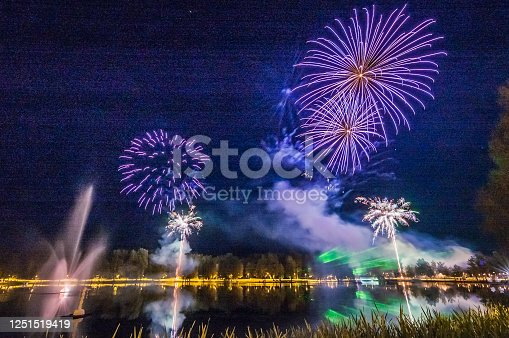 Beautiful various fireworks over the lake. Celebration.