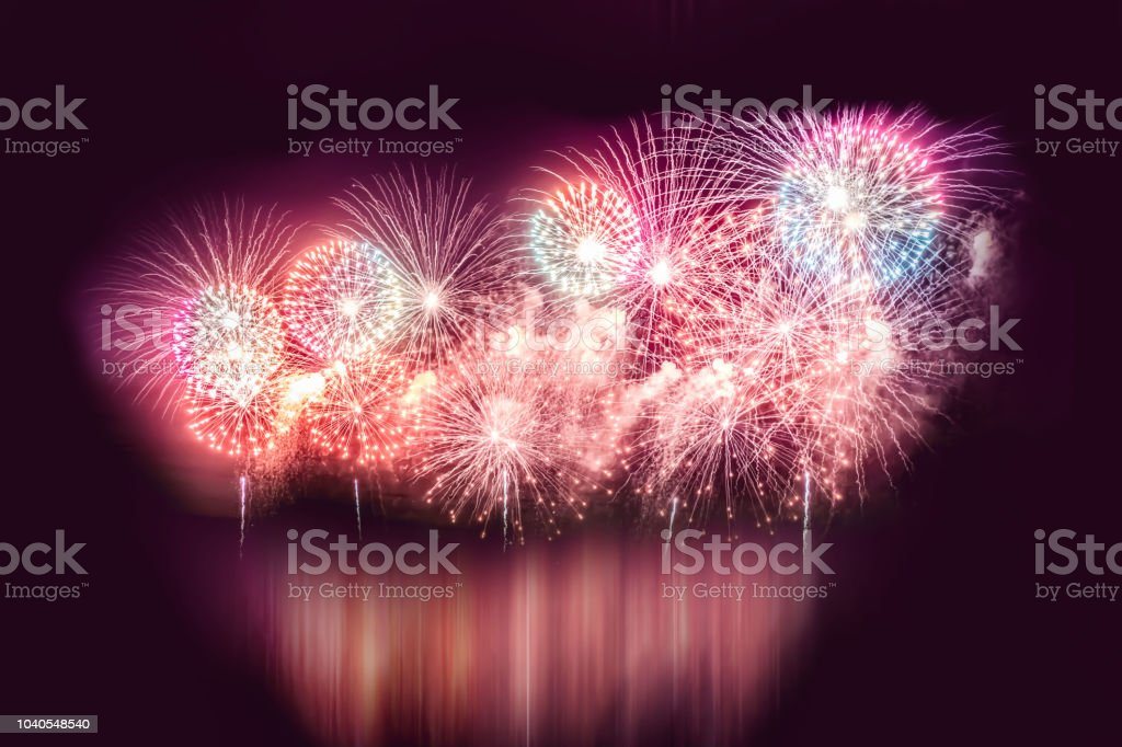 fireworks over the night city near the river stock photo