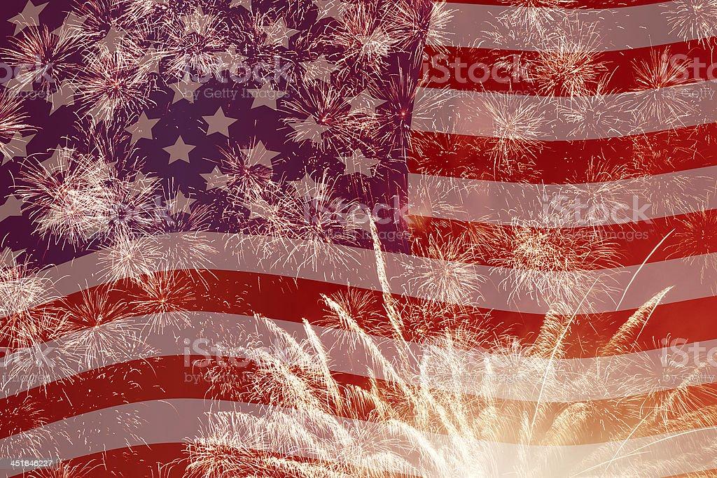 fireworks over United States flag stock photo