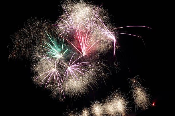fireworks pink star stock photo