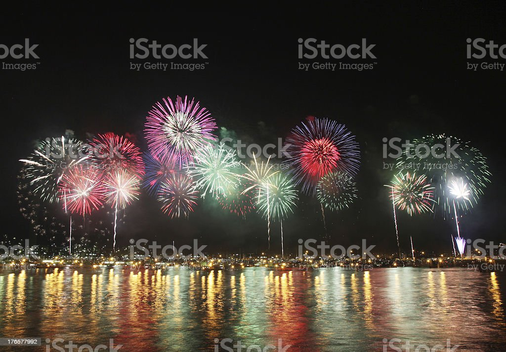 fireworks reflect on sea water stock photo