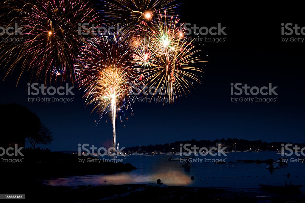 Fireworks show over water stock photo