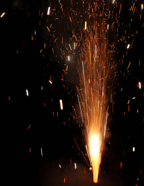 fireworks to celebrate the new year during a party - petard stock photos and pictures