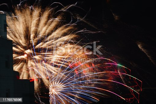 1008788822 istock photo Fireworks visible from Between building 1176576596