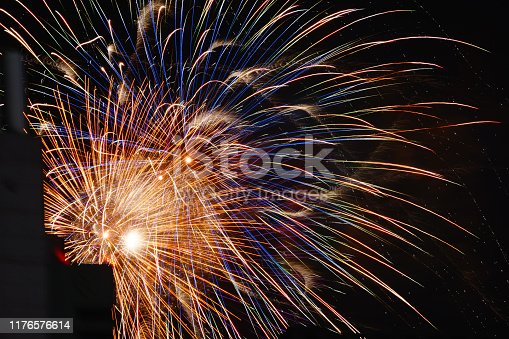 1008788822 istock photo Fireworks visible from Between building 1176576614