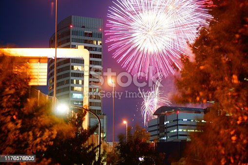 1008788822 istock photo Fireworks visible from Between building 1176576805