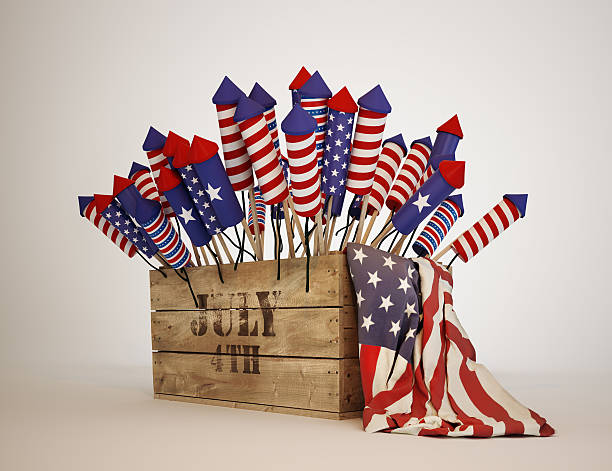 fireworks with us flag patterns sticking out of crate - petard stock photos and pictures