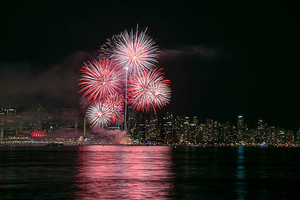 fireworks with vancouver city centre in the background - canada day stock pictures, royalty-free photos & images