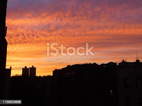 fire looking sunset sky over rooftops