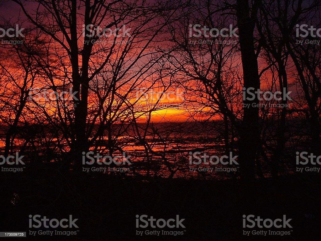 Firey sunrise.Lake Erie stock photo