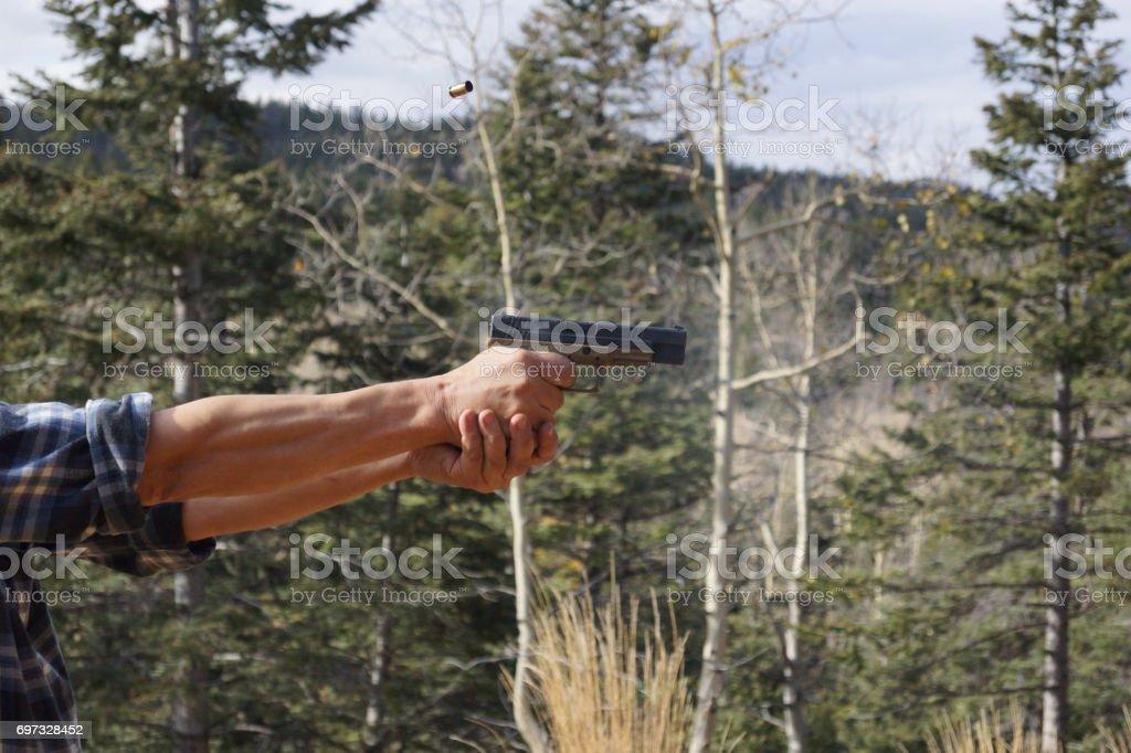 Firing a Gun stock photo