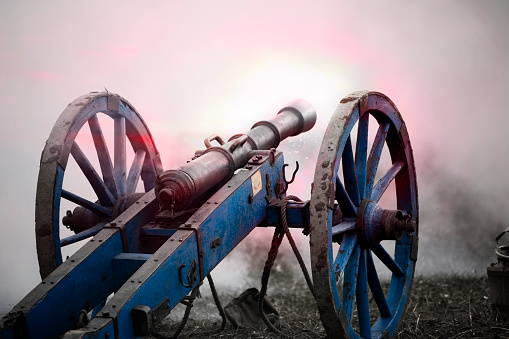 Firing, mounted, historic cannon in the smoke of the battlefield. Warfare of the 18th century. Nobody. XXXL (Canon Eos 1Ds Mark III)