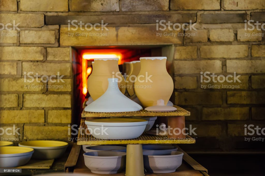 Firing of pottery in the oven stock photo