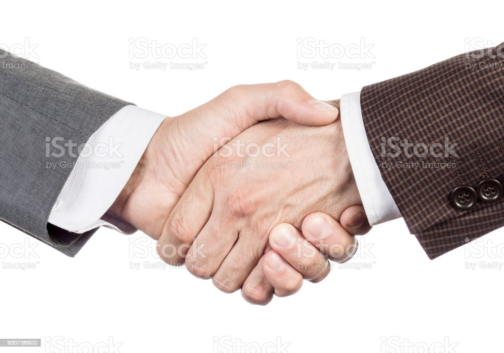 A firm handshake. Business partners shake hands. People in business suits make a handshake close-up isolated on white background. A successful business meeting. Partnership in business concept. stock photo