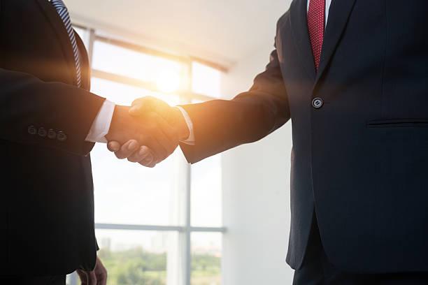 Firm handshake stock photo