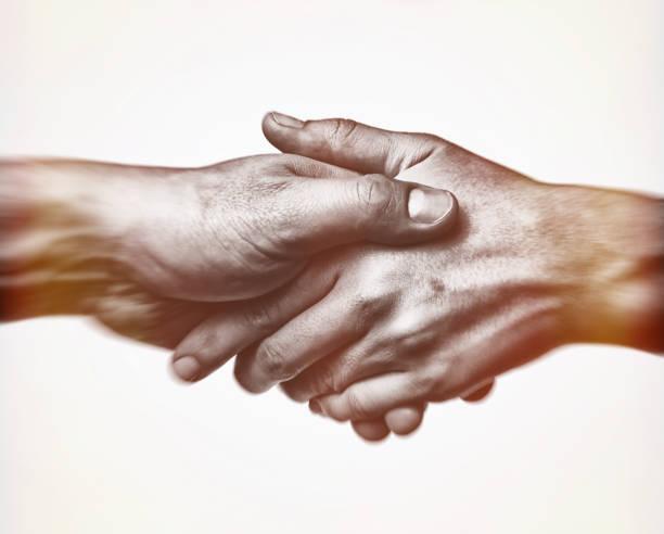 A firm handshake stock photo