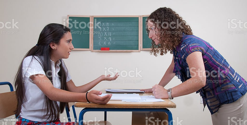 Firm Teacher And Rebel Student stock photo
