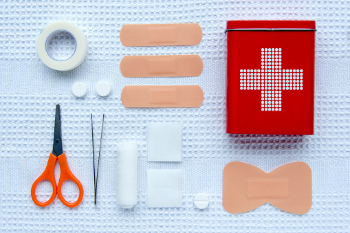 Knolling collection of first aid articles.