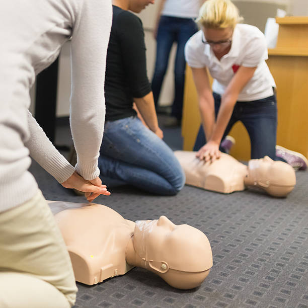 first aid cpr seminar. - first aid stock photos and pictures