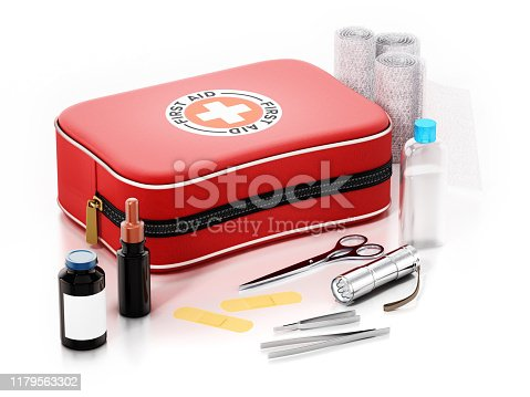 First aid kit and medical equipment isolated on white.