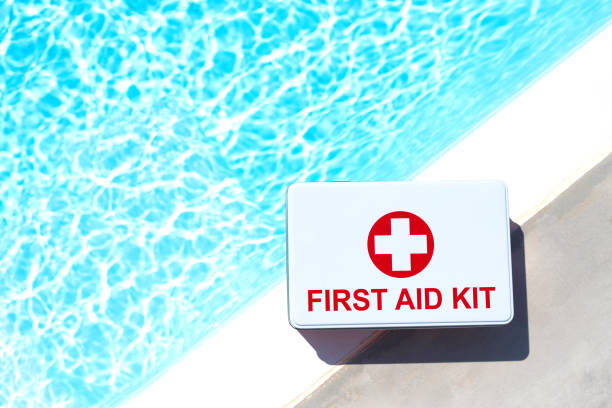 first aid kit near swimming pool. - icon set healthy foto e immagini stock