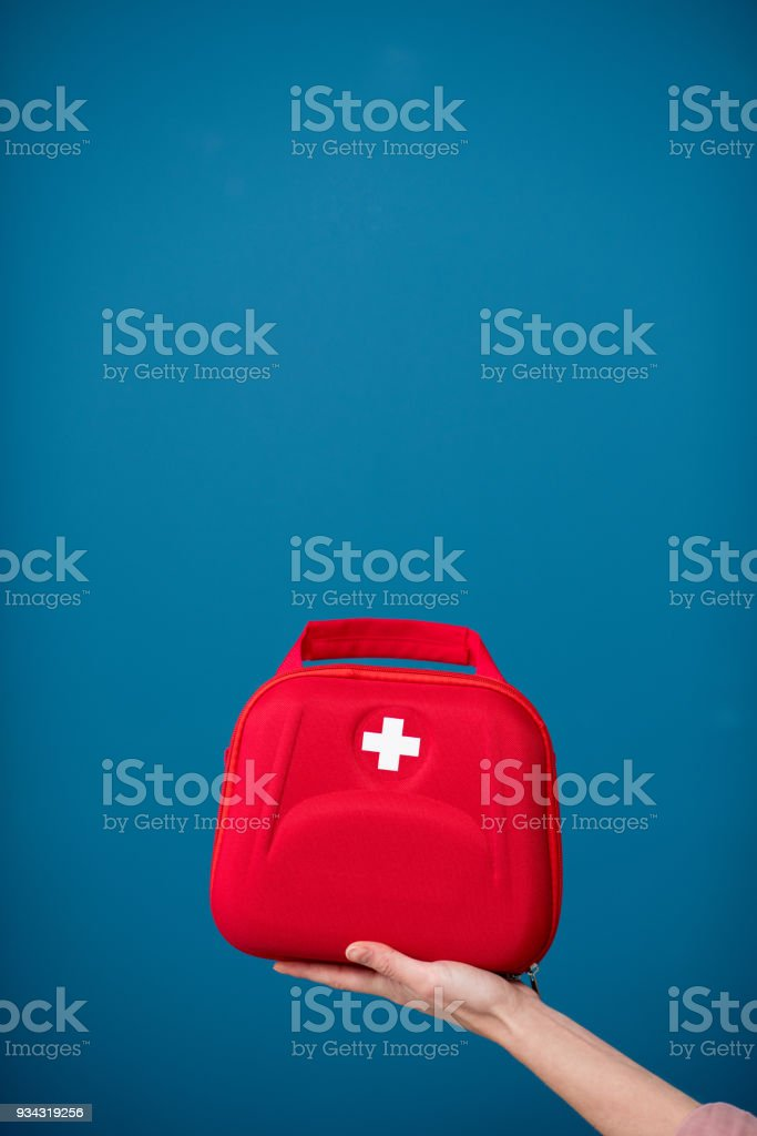 First aid kit on the blue background royalty-free stock photo