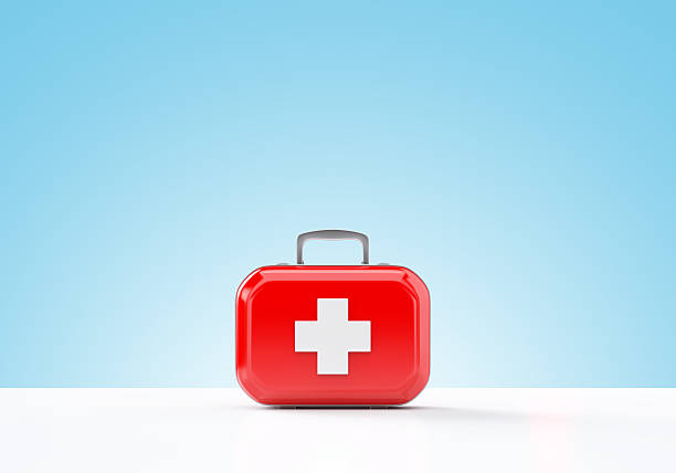 First aid kit standing on a blue and white background stock photo