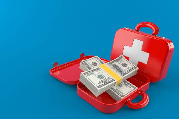 First aid kit with money - foto stock