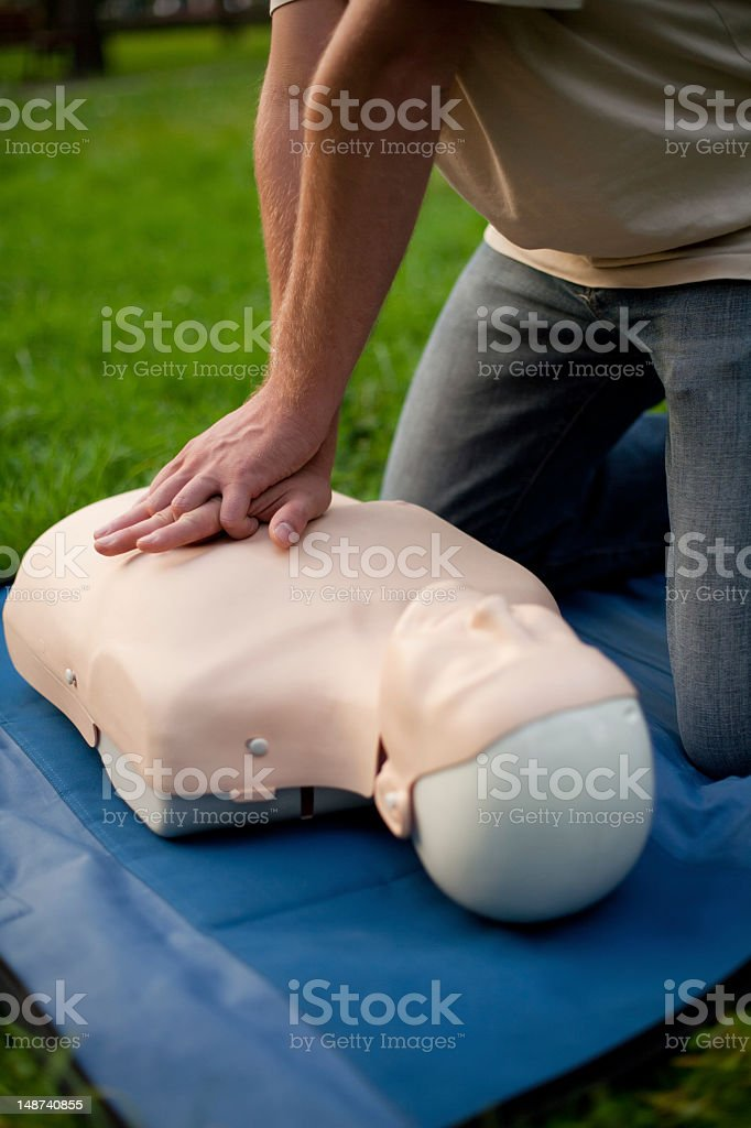 First aid on a cpr dummy performed in nature. Learn the first aid....