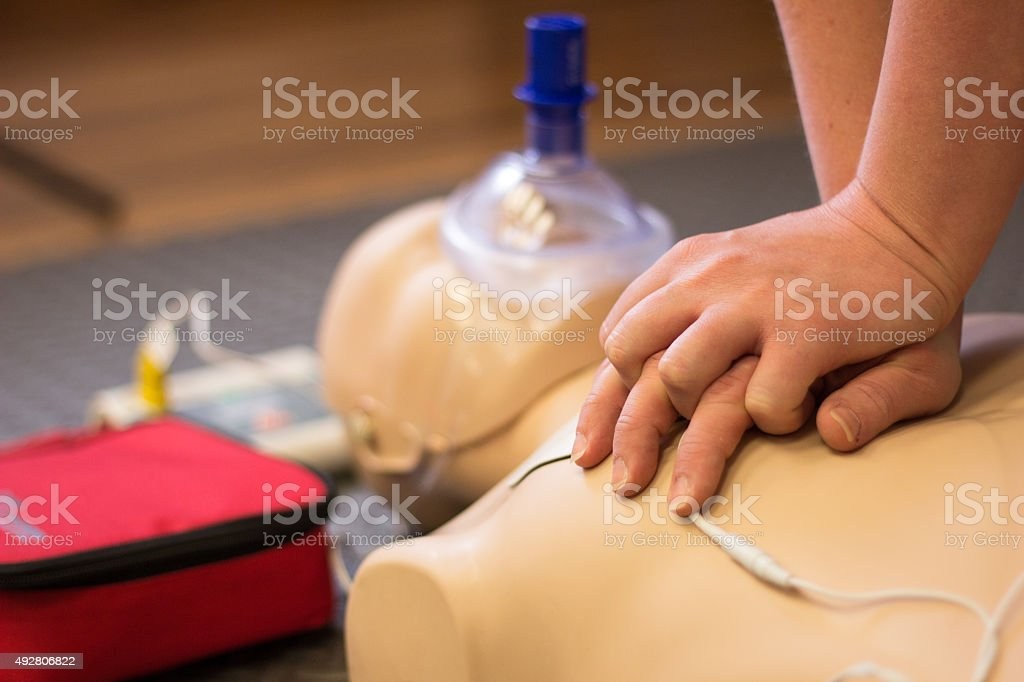 CPR First Aid CPR demonstration on manikin. 2015 Stock Photo