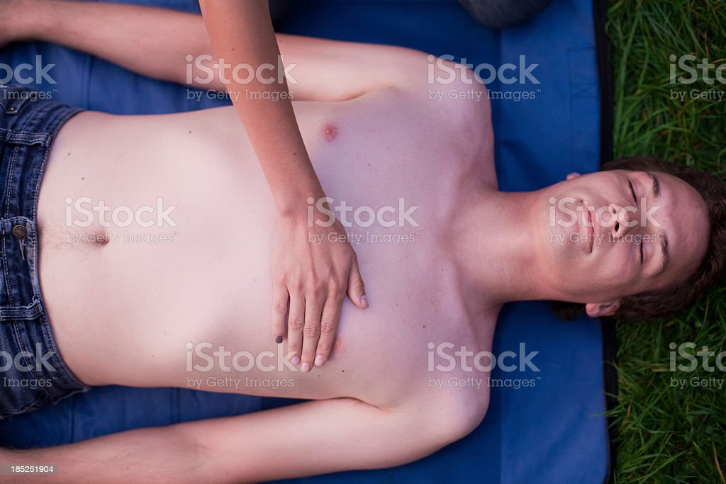 First Aid - Put hand in the middle of chest royalty-free stock photo