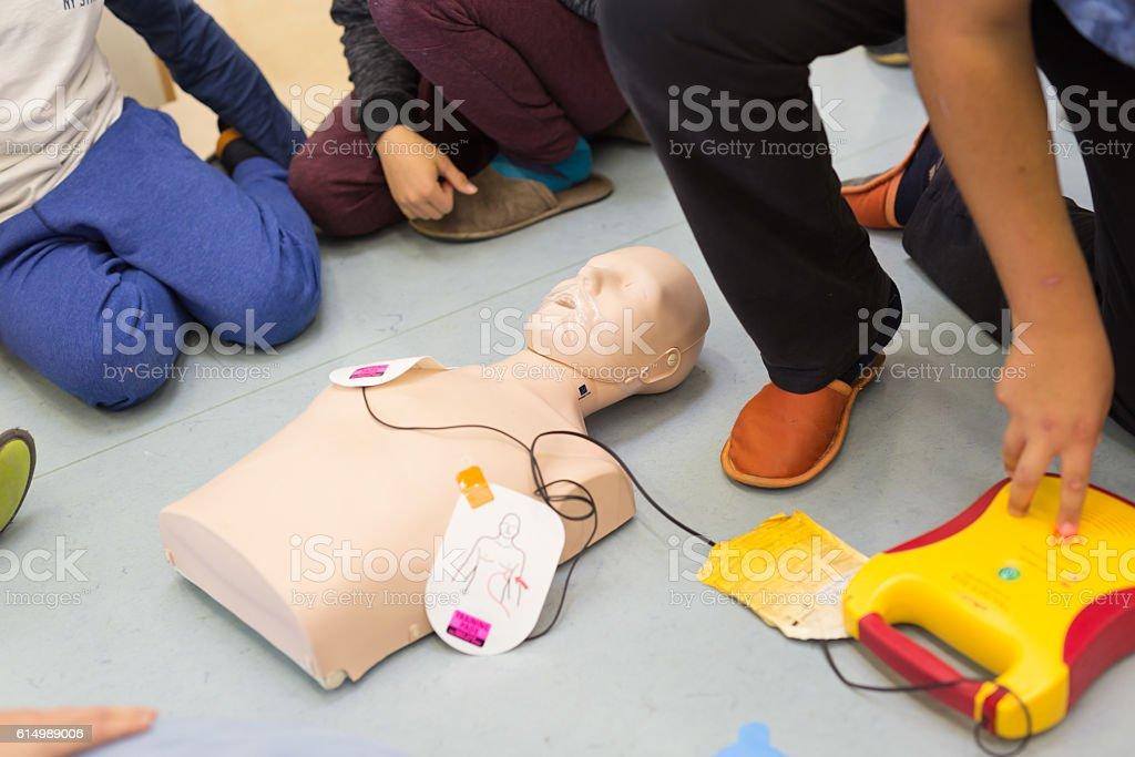 First aid resuscitation course using AED. Lizenzfreies stock-foto