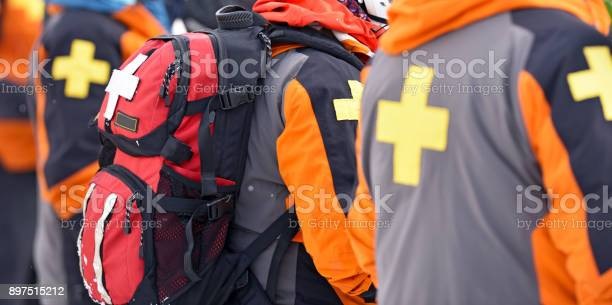 Photo of First aid ski patrol with backpacks