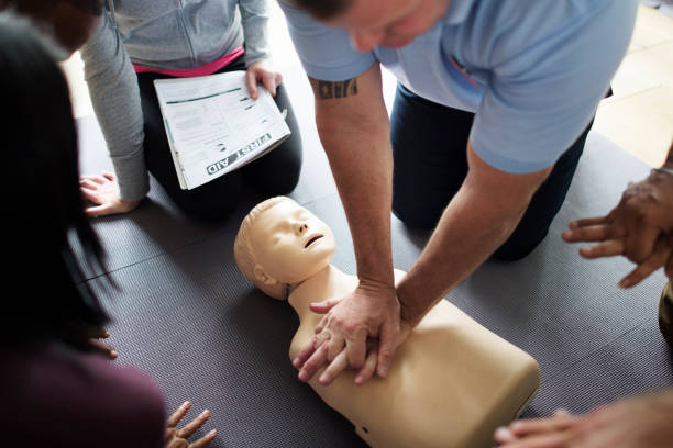 CPR First Aid Training Concept CPR First Aid Training Concept ambulance staff stock pictures, royalty-free photos & images