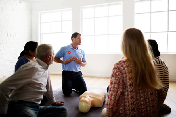 cpr first aid training concept - first aid stock photos and pictures
