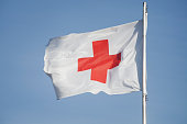 First Aid/Medic Red cross flag and blue sky.