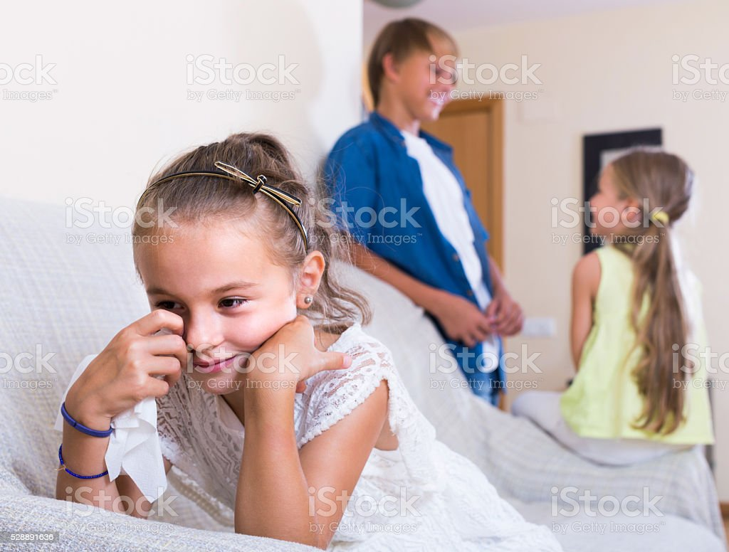 First amorousness:  girl and couple of kids apart stock photo